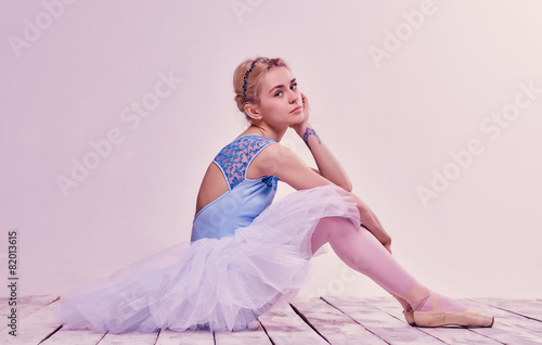 Aluminium Dance School Tired ballet dancer sitting on the wooden floor