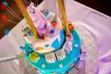 Christening cake with pink teddy bear