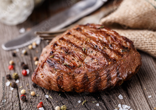 Beef steak on a wooden board Poster