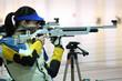 Leinwanddruck Bild - woman aiming a pneumatic air rifle