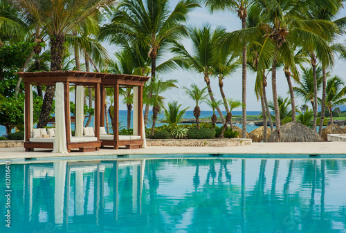 Swimming Pool at tropical beach - summer vacation background. - 82016413