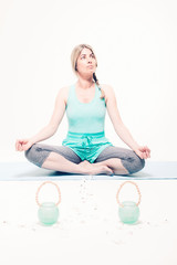 Woman Sitting in Lotus Position Looking Up