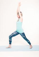 Fit Young Woman Doing Virabhadrasana I Yoga Pose