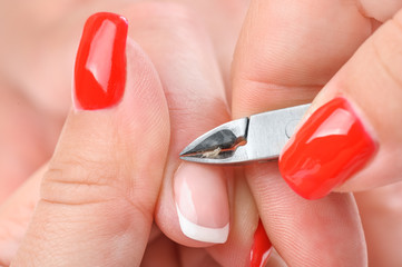 manicure applying - cutting the cuticle