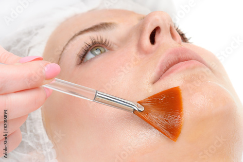 facial peeling mask applying