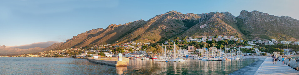 Panorama of Gordons Bay harbor and Hottentots-Holland Mountains