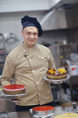 chef preparing desert cake in the kitchen