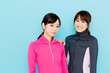 sporty asian women on blue background