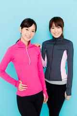 sporty asian women on blue background