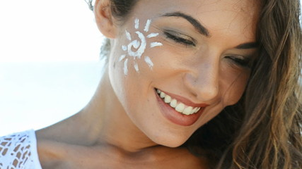 Smiling Girl With Sun Lotion
