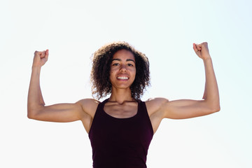 Strong African American Woman flexing biceps