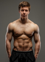 Attractive muscular young bodybuilder