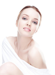 Cute young woman on white background