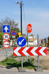 Traffic signs at the road crossing