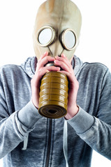 Young man wears a gas mask