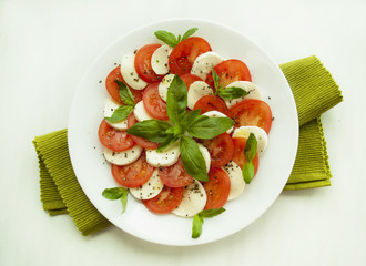 Caprese salad with tomatoes, mozarella and basil