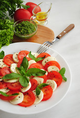 Caprese salad with tomatoes, mozarella cheese