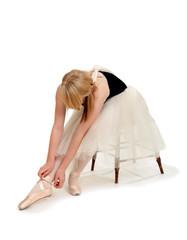 Ballerina Preparing Pointe Shoes