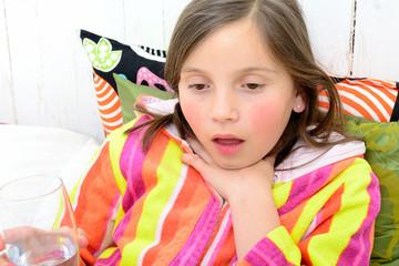a little girl has a sore throat