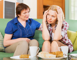 Two female sharing bad news
