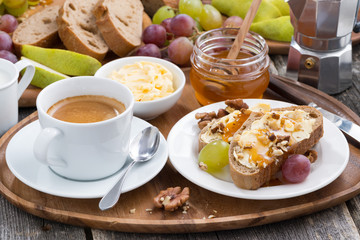 bread with butter, honey, nuts and grapes for breakfast