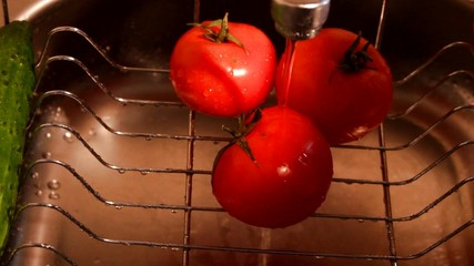 Tomatoes washing at the kitchen