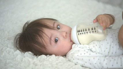 asian baby drinking from bottle,close up