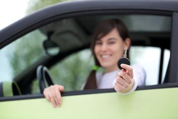 Driver woman showing new car keys