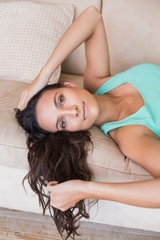 Pretty brunette relaxing on the couch