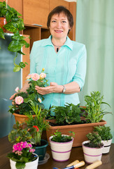 Smiling mature woman and  her small garden