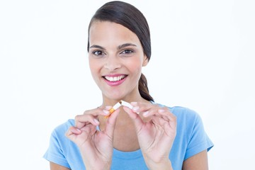 Happy woman breaking a cigarette