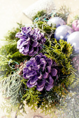 Christmas decoration with greens, painted cones and balls