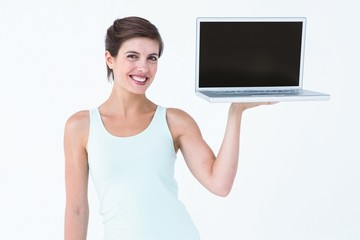 Attractive woman showing her laptop