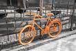 Orange bicycle on the gray background