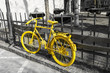 Yellow bicycle on the gray background