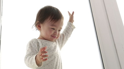 asian Adorable baby laughing