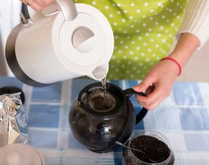 Closeup of  housewife making tea