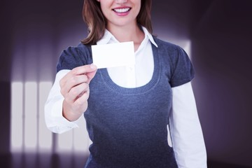 Composite image of smiling woman showing card