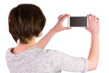 Pretty brunette taking a picture with her smartphone