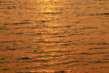 close up sea wave in sunset