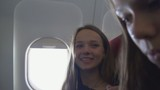 Young women traveling by plane together