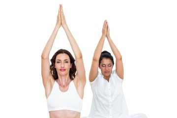 Relaxed women raising arms