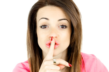 Woman with big lips making silence sign