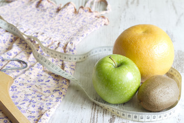 Lose weight to clothes concept with dress and fruits diet