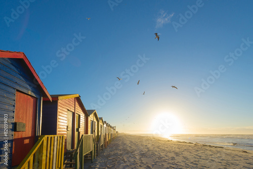 Foto op Canvas Zuid Afrika Sunrise at the famous colorful beach huts at Muizenberg Beach