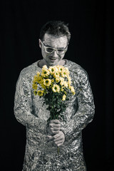 Satisfied spaceman with flowers