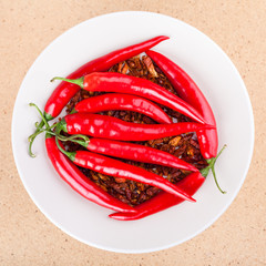 Red chili peppers on plate