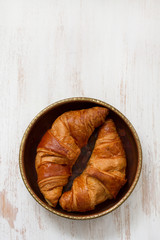 croissants in dish on white background