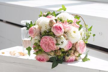 Wedding bouquet and bottle of perfume