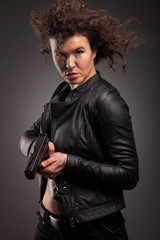 elegant and sexy lady with a gun pistol in hands. woman killer